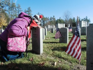 Widow at the grave of her hero.
